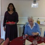 Sharing home made cakes at Delves Court Care Home