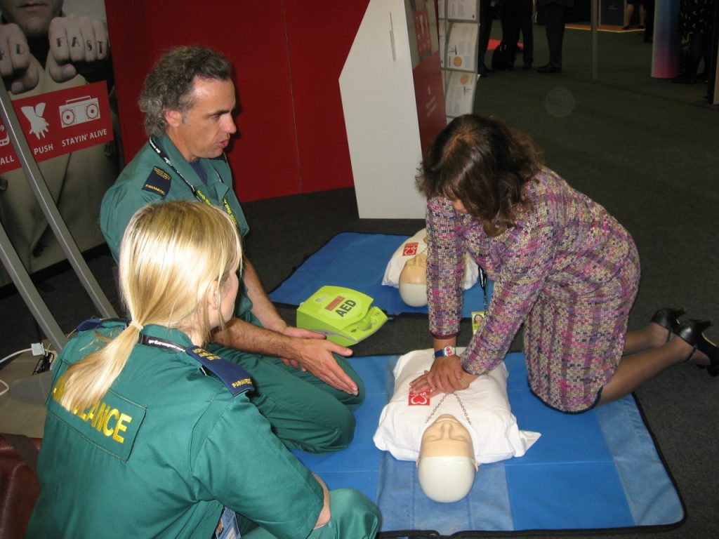 Valerie practicing Hands-only CPR
