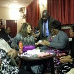 Valerie presents gifts to members of WACC